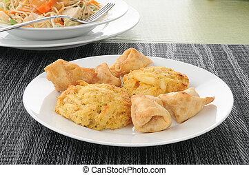 Appetizer plate of crab rangoon and crab cakes