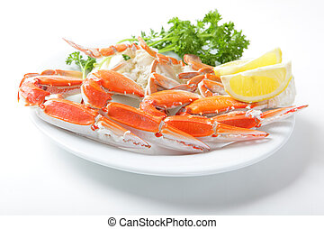 Crab legs with lemon and parsley