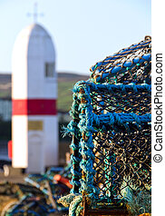 Crab nets closeup with Lighthouse in background