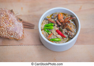 Crab stew with coconut milk, minced pork