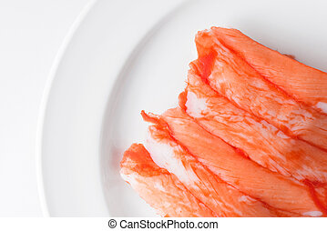 crab stick on white plate