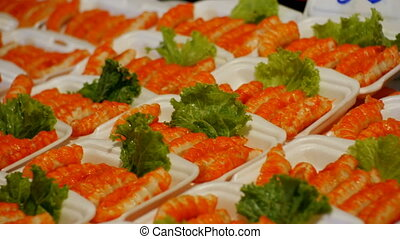 Crab sticks or fish cutlets in a plate on the counter. Asian...