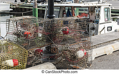 Crab traps stacked at the docks - Crab traps are sitting on ...