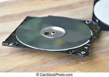 crack diskette on wooden board
