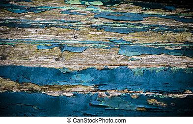 cracked blue paint on wood