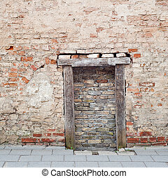 cracked brick wall with bricked up doorway