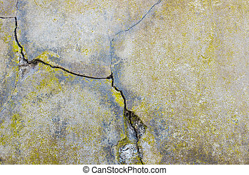 Cracked cement wall, detail of a wall damaged by the passage...