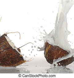 cracked coconut with big splash, isolated
