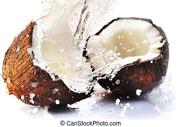 cracked coconut with splash - cracked coconut with big ...