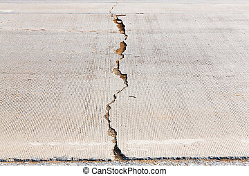 Cracked concrete road - Close up weathered and creacked...
