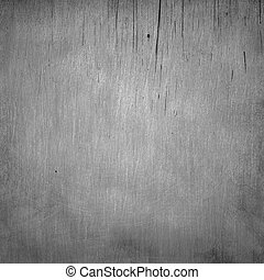 Closeup of cracked stained driftwood as background texture