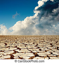 cracked earth and dramatic sky
