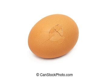 A cracked egg isolated on white background.