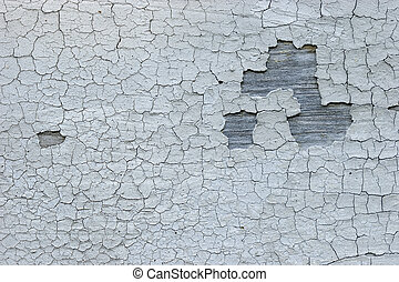 Cracked faded paint - The old cracked faded paint on a...