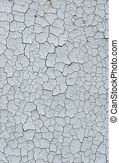 Cracked faded paint - The old cracked faded paint on a ...