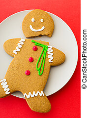 Cracked Gingerbread cookie with pink background