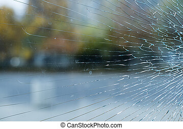 Cracked glass and city background
