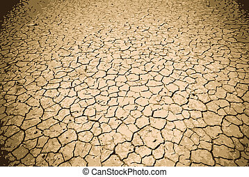 Cracked Ground - Badly cracked earth under a scorching sun