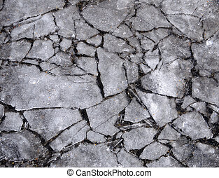 Cracked Ice over Sidewalk Pavement Background