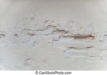 Cracked of white brick wall