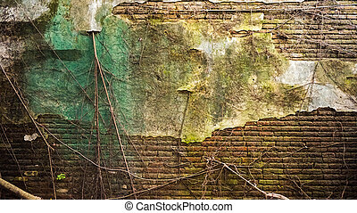 Cracked old brick and concrete wall covered with moss and tree trunk. high humidity abandon texture background