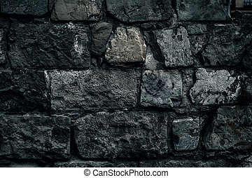 Cracked old stone wall background, grunge texture close up