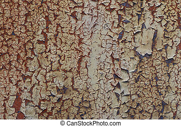 Cracked paint on the rusty metal
