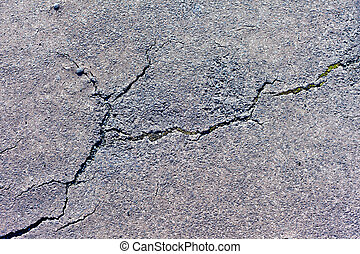 Cracked Pavement - Cracks in asphalt pavement of walkway.