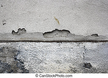 cracked plaster surface on damp wall