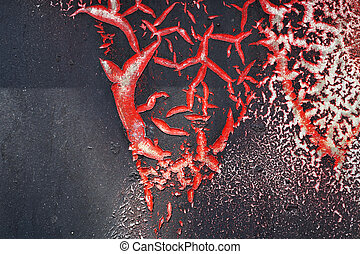 Cracked red paint on grunge metal surface - macro 1