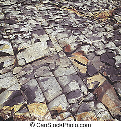cracked stone rock in the style of grunge