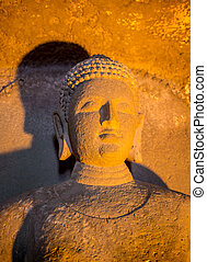 Cracked surface of old Buddha statue