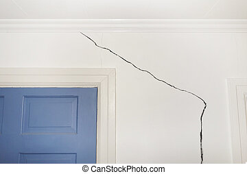 Cracked wall - Crack in the wall of a home