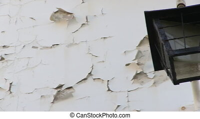 Cracked wall with lamp - A medium shot of cracked wall with...