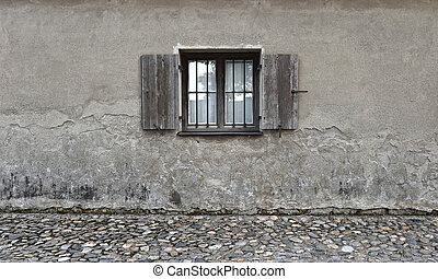 Cracked wall with old wooden window. Stone texture background