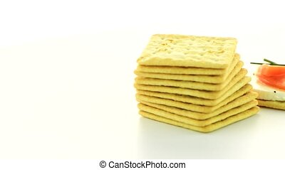 Cracker cookies appetizer rotate on a white background.