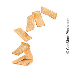 crackers fall on the stack of square crackers isolated on white background