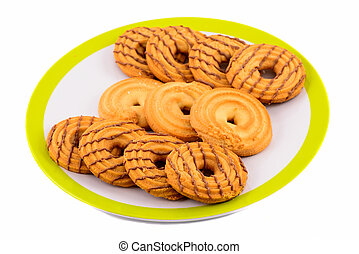 crackers in plate on white background