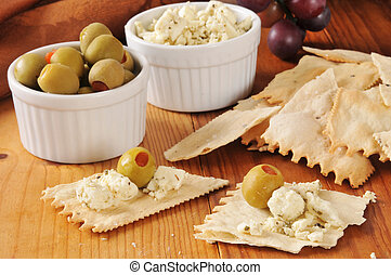 A Mediterranean snack with flatbread crackers, olives and feta cheese