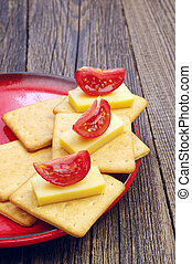 Crackers with cheese and tomato