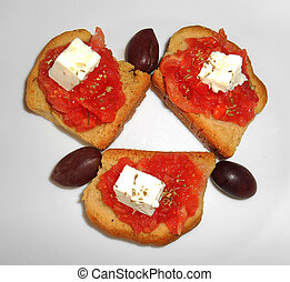 Crackers with feta, tomato, olives