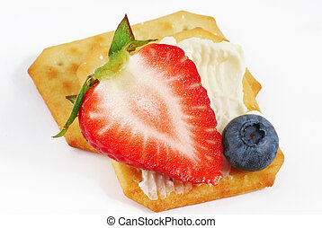 Crackers with some cream and fruits