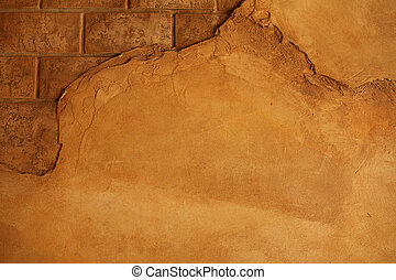 cracking brick wall - warm brown wall with plaster peeling ...