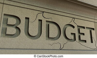 Cracking BUDGET word on the stone facade. Corporate or...