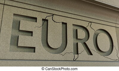 Cracking EURO word on the stone facade. European financial...
