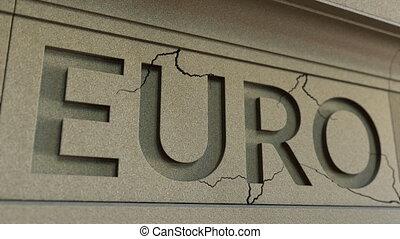 Cracking EURO word on the stone facade. European financial...