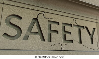 Cracking SAFETY word on the stone facade. Security breach...