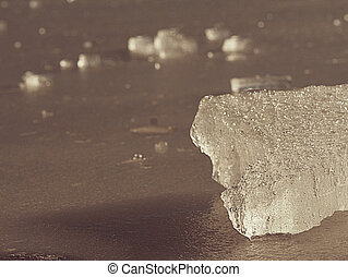 Cracks and bubbles in broken ice piece. Drifting ice floe