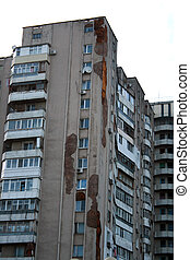 Cracks and stains on the walls of the high-rise building. Dampness