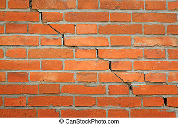 cracks in red brick wall